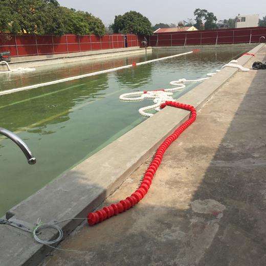 Thi công dây phao chắn sóng bể bơi